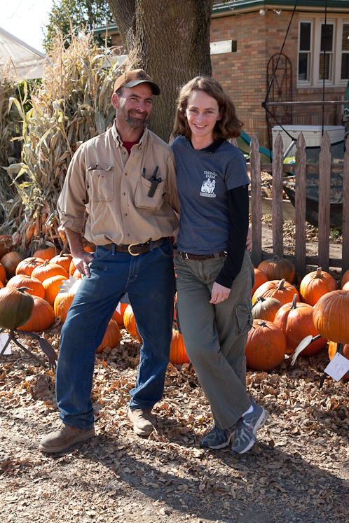 Photo: Alan and Angie Treinen standing in front of a display of pumpkins