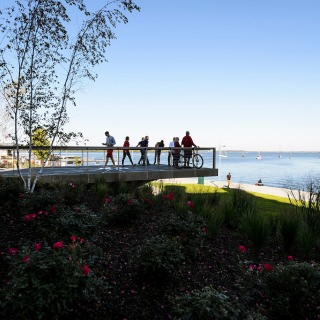 People take in the view of Lake Mendota from Alumni Park's Progress Point.