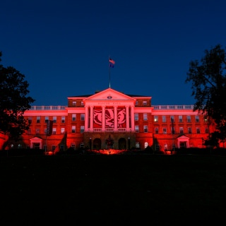 In honor of Homecoming Week, red accent lighting illuminates Bascom Hall.