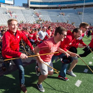 Law School students prepare to run the length of the field and take part and in the annual Cane Toss event just before the start of the UW Homecoming football game. While the origin of this 1930s-era tradition is unclear, the goal for the third-year law students is to toss their canes over the goal post and catch them on the other side. Legend holds that those who do so successfully will win their first legal cases; those who don't, or catch the wrong cane, will have to settle.