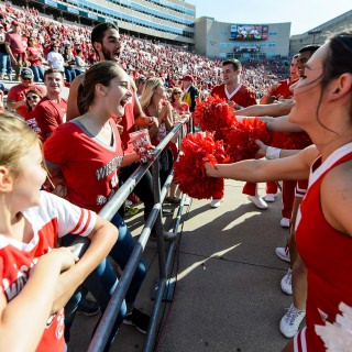 Members of the UW Spirit Squad engage with fans during the fifth quarter celebration.