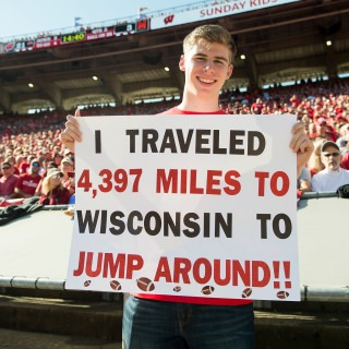 Martin Janku, a Badger and Jump Around fan from the Czech Republic, holds up a sign describing his commitment.