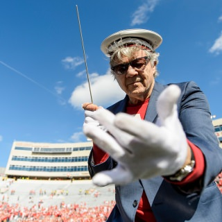UW-Madison alum Steve Miller, of the Steve Miller Band, conducts the UW Marching Band.
