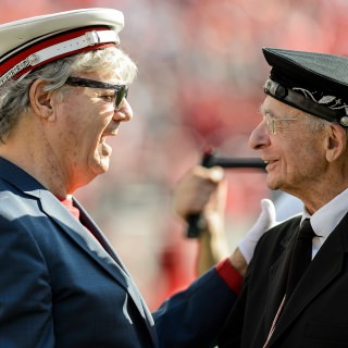 UW-Madison alum Steve Miller, of the Steve Miller Band, talks with UW Band director Michael Leckrone during the fifth quarter celebration.