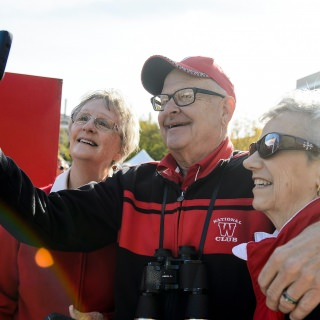 Badger fans Judy Anderson, Tom Arzner and Laurie Juno show take a selfie together prior to the UW Homecoming football games against Maryland.