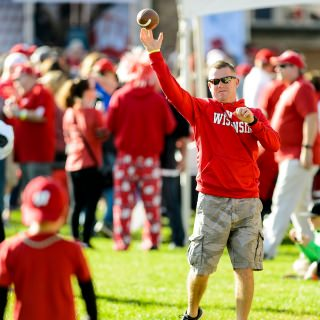 David Putz and his son Drennan toss a football around during the Badgerville pregame event.