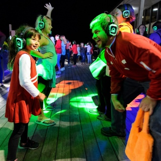 UW alum Chris Harrison and daughter Sophia dance the night away at the silent disco event during the UW Homecoming Block Party at Alumni Park.