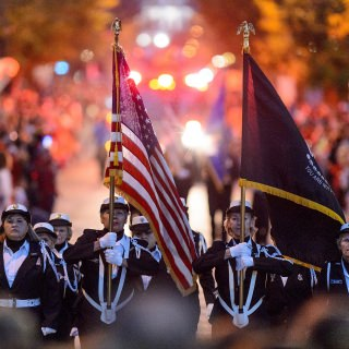 Members of the UW Honor Guard make their way down State Street during the annual Homecoming Parade.