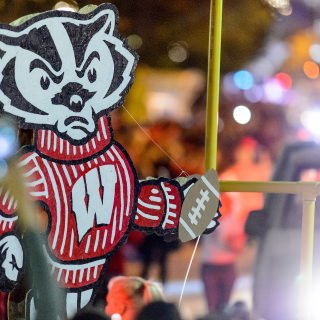A parade float featuring iconic UW-Madison's mascot Bucky Badger makes its way down State Street.