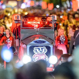 The Bucky Wagon make its way down State Street during the annual Homecoming Parade.