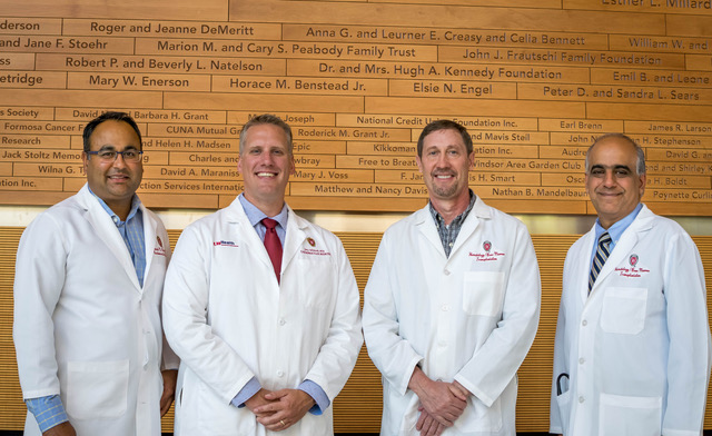 Photo: Peiman Hematti, John Kink, Eric Schmuck and Amish Raval standing in lab coats