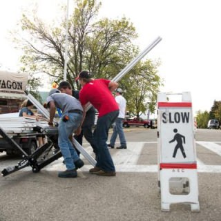 Signage chairs — and UW–Madison students —  work to move signs before the World Dairy Expo begins.