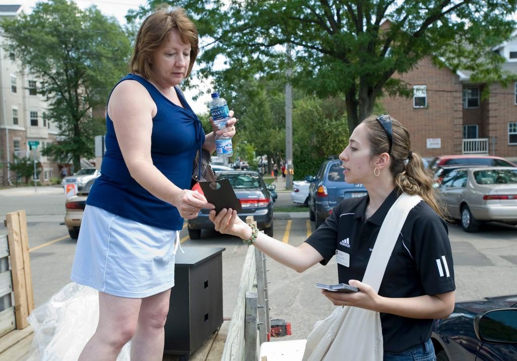 Photo: Nancy Hoffman handing information to parent