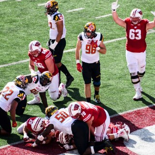 Wisconsin fullback Austin Ramesh (#20) makes a touchdown as the Wisconsin Badgers take on the Maryland Terrapins.