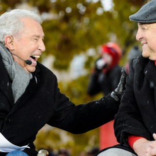 Commentator Lee Corso, left, talks with Athletic Director Barry Alvarez.