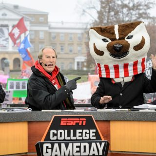 The day's celebrity guest, actor Craig T. Nelson, closes the broadcast with Corso clad as Bucky Badger.