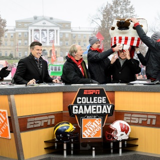 Corso draws cheers from the crowd by picking Wisconsin to defeat Michigan.