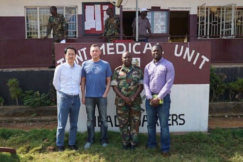 Photo: Team standing in front of military hospital