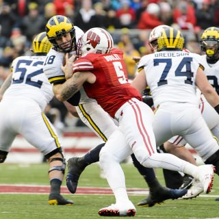 Badgers outside linebacker Garret Dooley (5) sacks Michigan quarterback Brandon Peters (18).