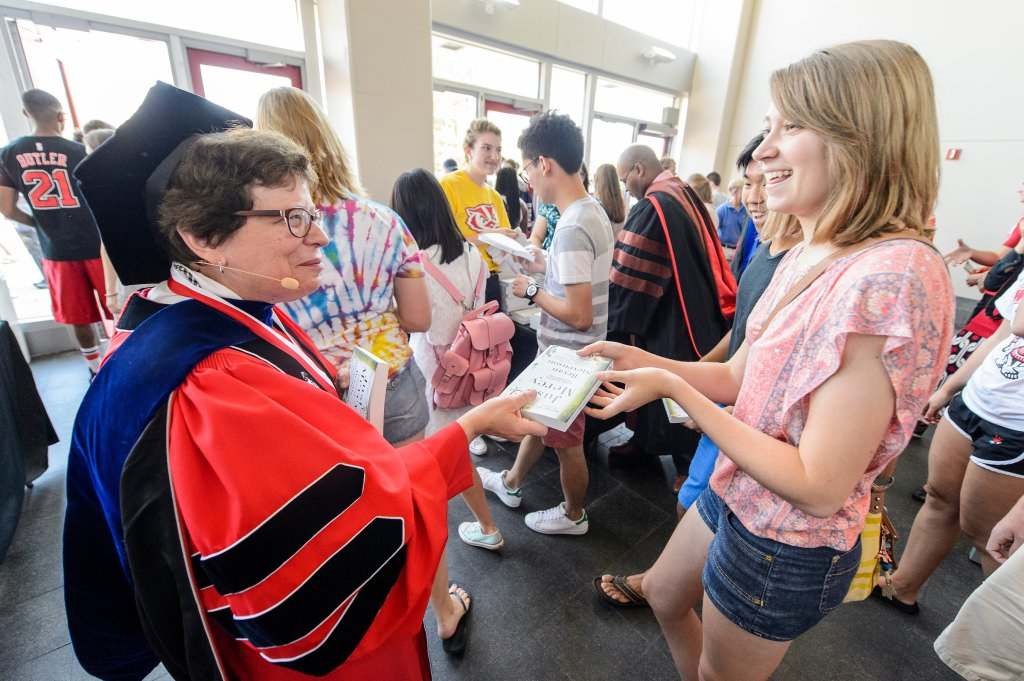 Photo: Rebecca Blank handing book to student
