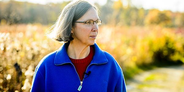 Photo: Karen Oberhauser walking on Arboretum path