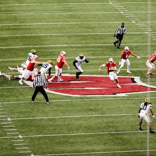 Wisconsin quarterback Alex Hornibrook (12) makes a break up the middle of the field as the Wisconsin Badgers play against Michigan Wolverines at Camp Randall Stadium.