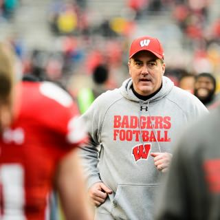 Wisconsin Head Coach Paul Chryst runs off the field after reaching Wisconsin Badger's 11-0 season.