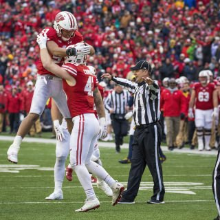 Linebackers T.J. Edwards, left, and Ryan Connelly, right, celebrate the 24-10 victory over Michigan.