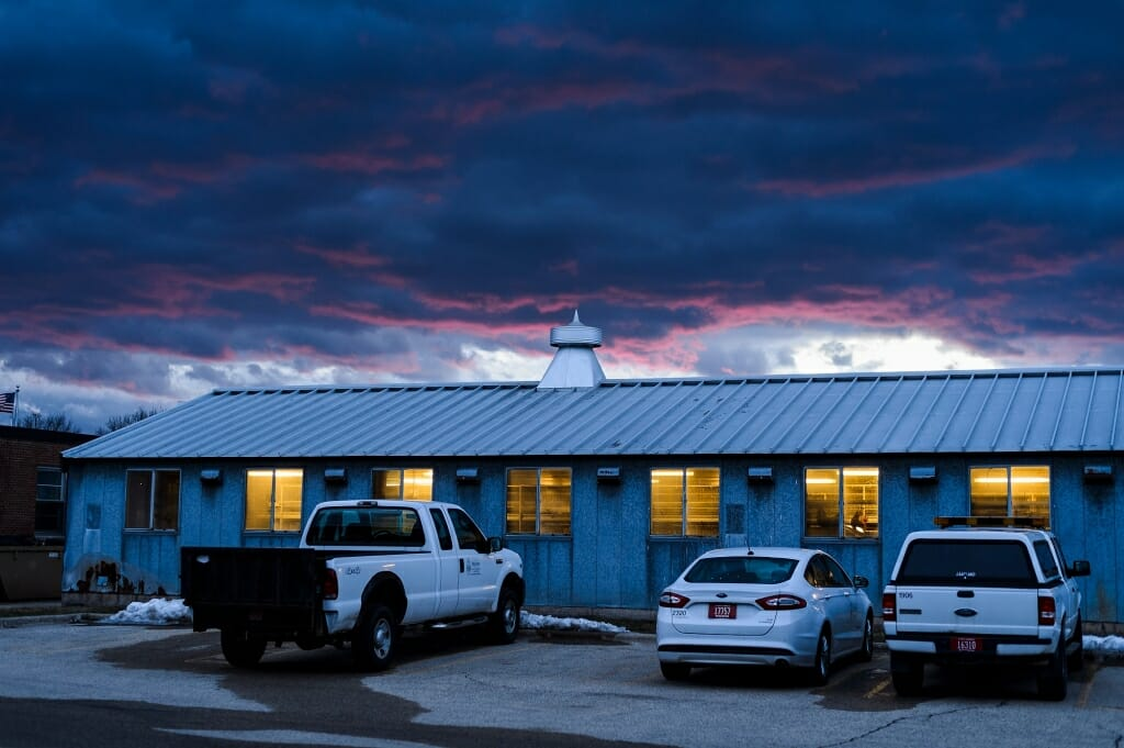 Photo: Clouds and sunset behind Poultry Research Lab