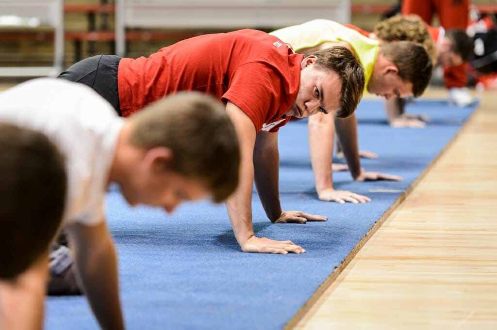 Photo: Student doing push-ups watching others doing the same