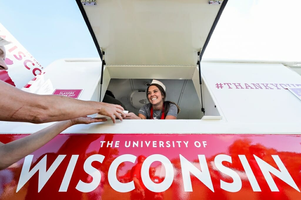 Photo: Woman serving ice cream from window in truck