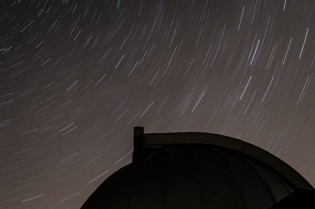 Photo: Stars seeming to form trails above observatory