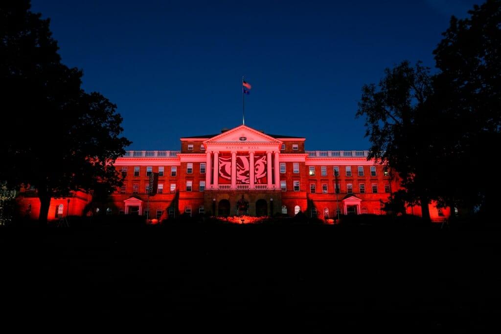 Photo: Bascom Hall illuminated by red lights