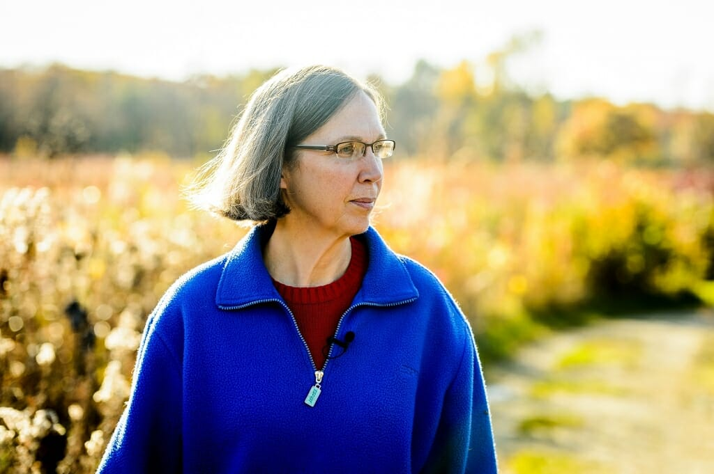 Photo: Karen Oberhauser walking along trail