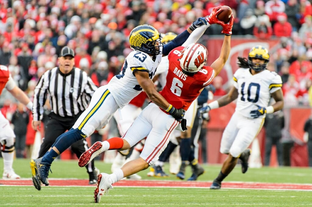 Photo: Wisconsin player catching pass over Michigan defender