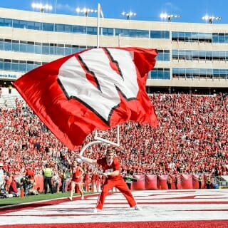 A spirit squad member waves the W after the Badgers score a touchdown on Oct. 21 against Maryland. The Badgers won 38-13.