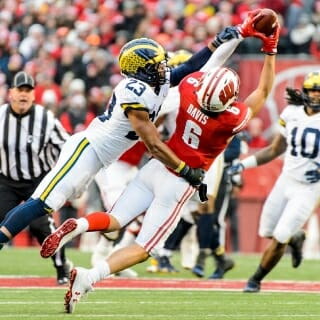 Wisconsin Badger's Danny Davis (6), wide receiver, goes up for a pass against the Michigan Wolverines.