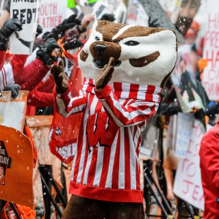 As cold rain falls, UW-Madison mascot Bucky Badger cheers on fans as ESPN College GameDay broadcast a live show on Bascom Hill before the game against Michigan on Nov. 21.