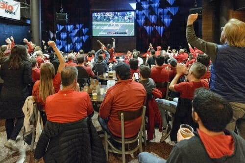 UW Badger fans gather together inside The Sett at Union South to watch the Big Ten Championship game between Wisconsin and Ohio State on Dec. 2, 2017. photo by bryce richter