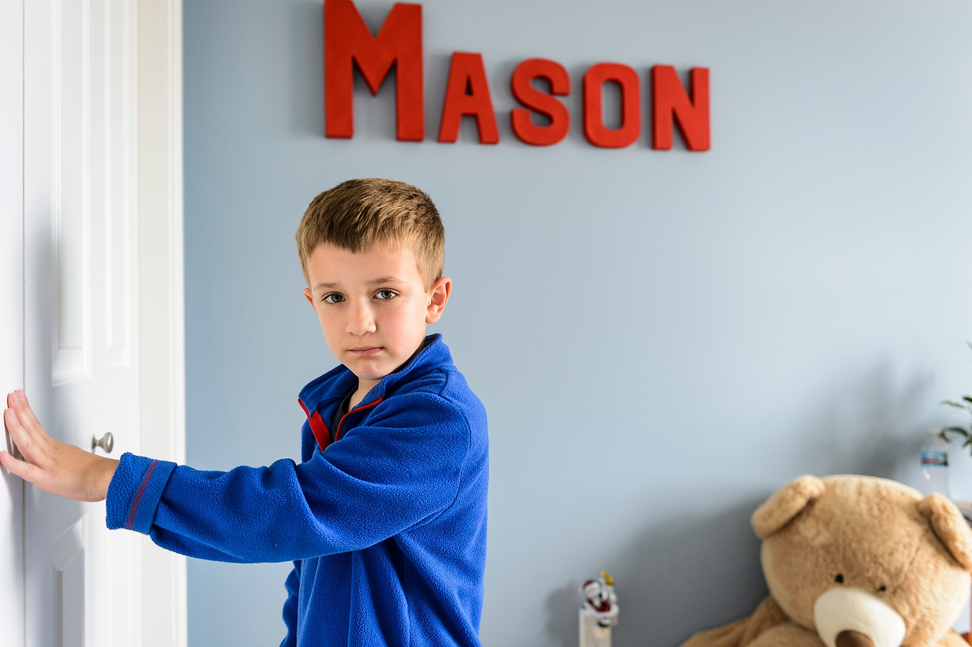 Mason Konsitzke, 7, plays in his bedroom at home in Stoughton.