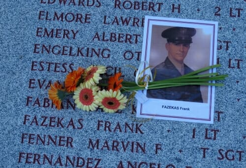 Photo: Photo of Fazekas in uniform on top of memorial with his name carved in it