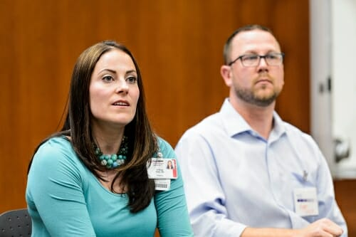 A photo of Lindsay and Ryan Geier at a panel discussion about NF1. Their daughter has the disease.