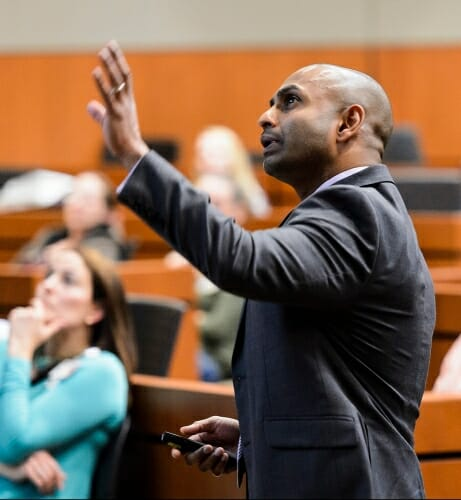 "Dhanansayan ""Dhanu"" Shanmuganayagam gestures while he speaks about his NF1 research at a symposium for patients and families at UW–Madison in May."