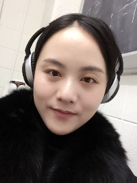 Photo: Yan Yu wearing headphones