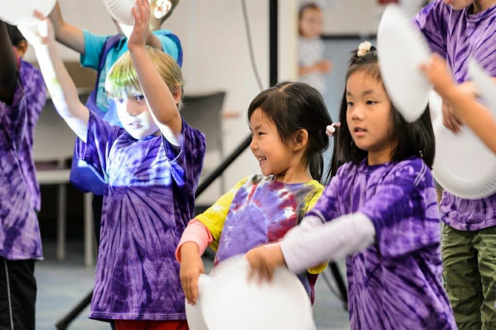 Photo: Children in purple tie-dyed t-shirts