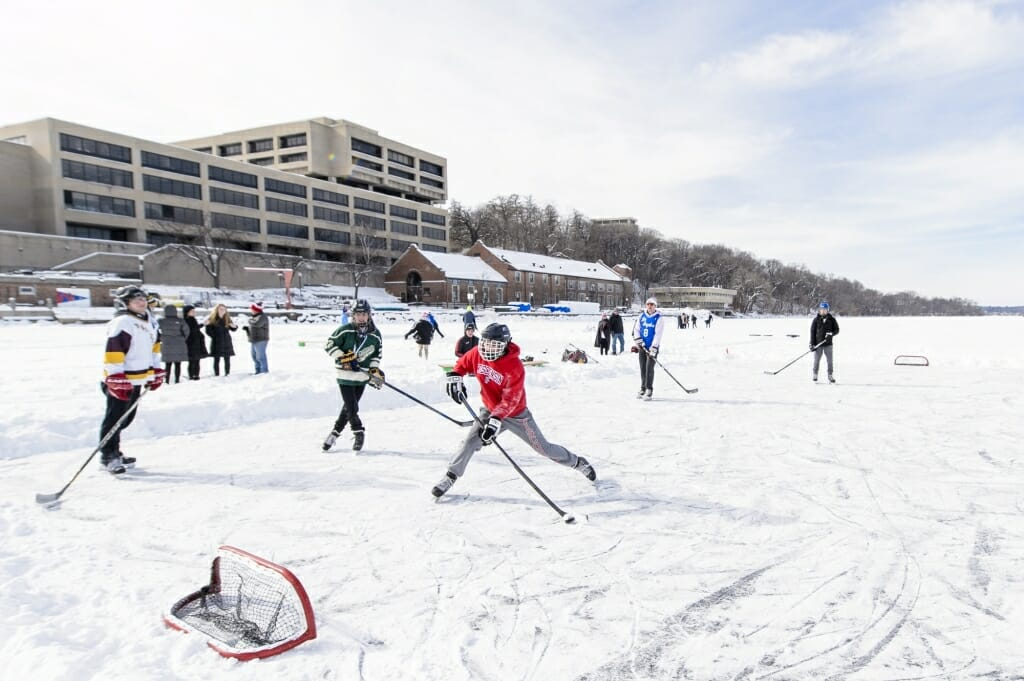 Photo of students playing hockey.
