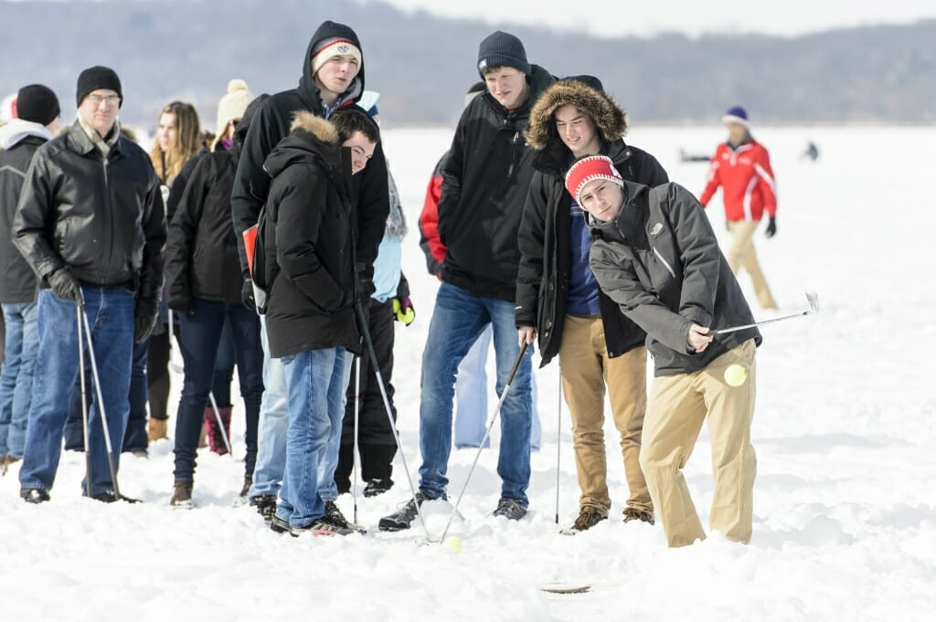 Photo of Joe Tenpenny and friends playing a round of ice golf.