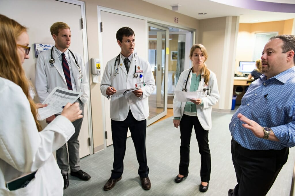 Photo: Josh Medow talking to medical students in ICU