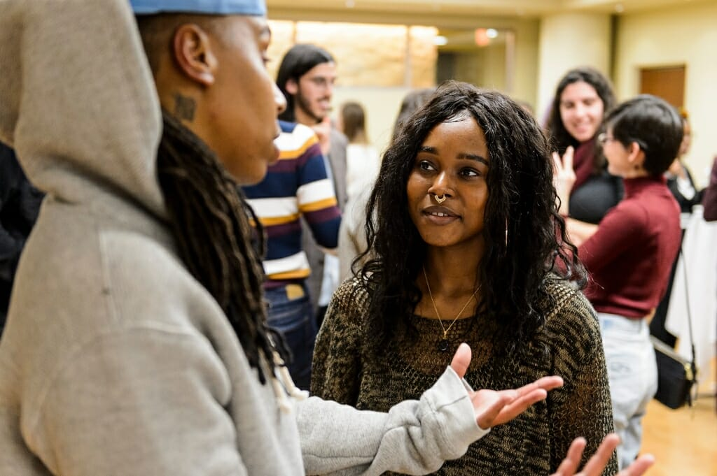 Undergraduate Janetta Hill, with the First Wave program, talks with Waithe.