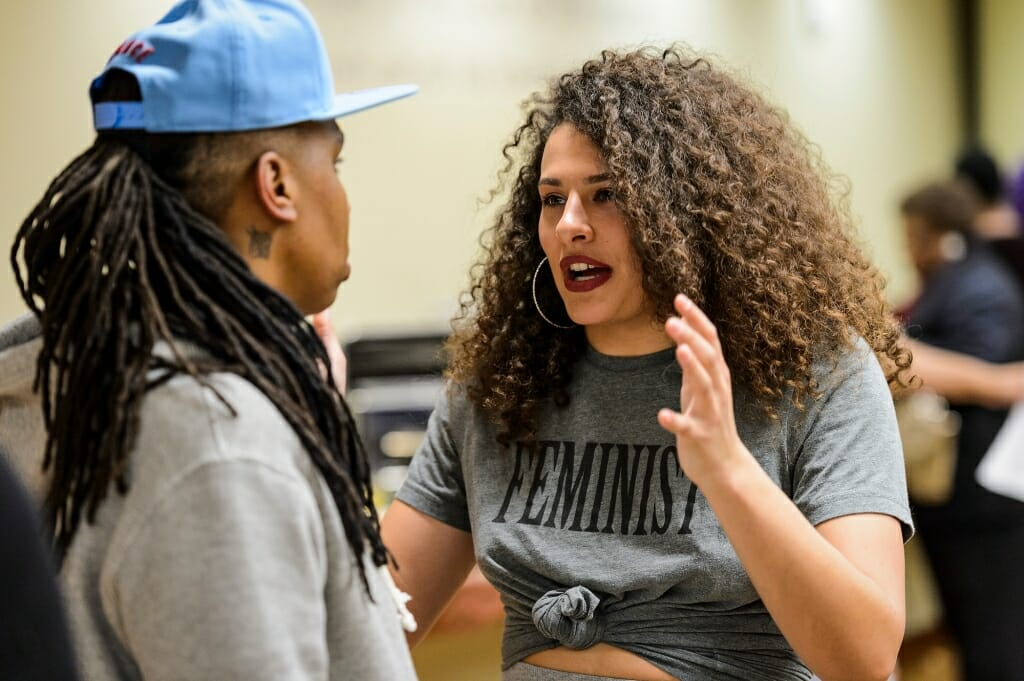 Undergraduate Kaitlynne Roling, a Chancellor-Powers Knapp Scholar, talks with Waithe during a meet-and-greet session with invited UW-Madison students.